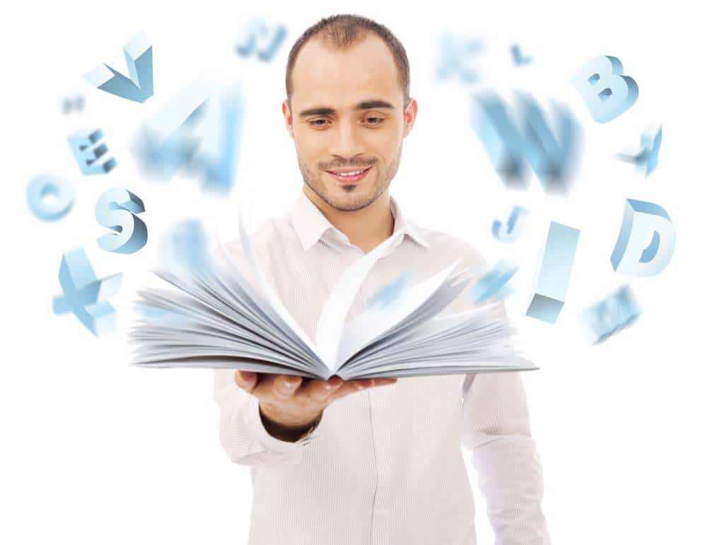 Adult man holding an opened book and reading. Letters are flying from the book. Self education of business school concept